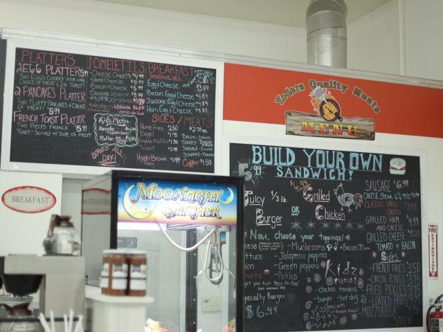 chalkboard menu over a deli counter