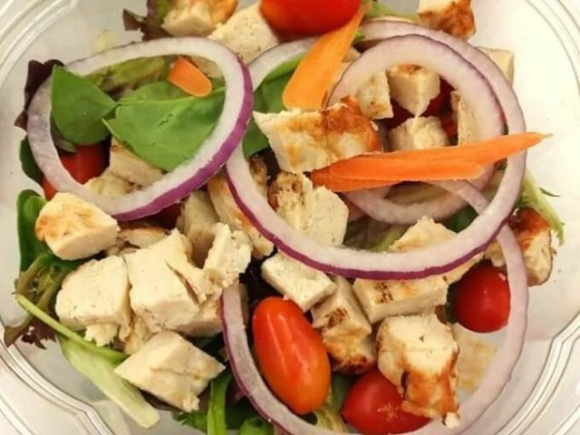 fresh salad with chicken and a lot of veggies