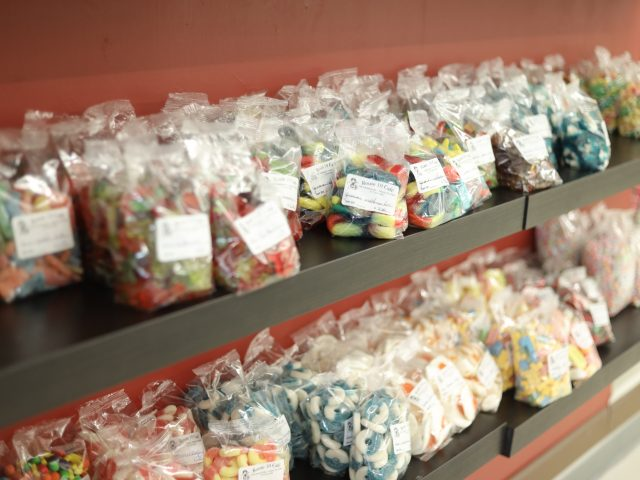 bags of different types of gummy candy for sale