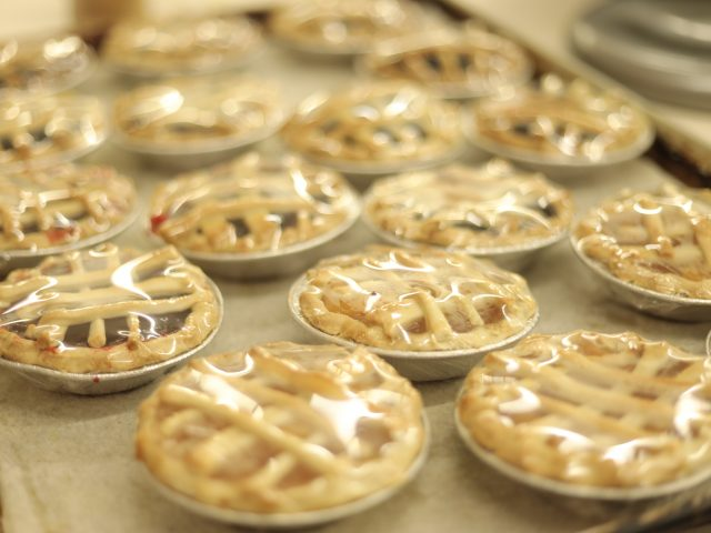 freshly baked mini apple and cherry pies
