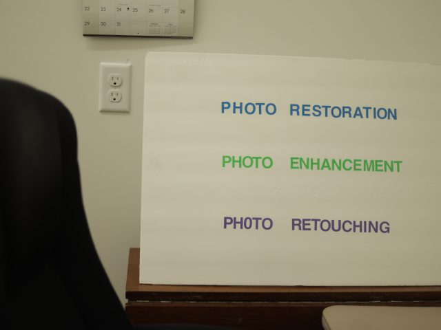 photo restoration and enhancement services sign
