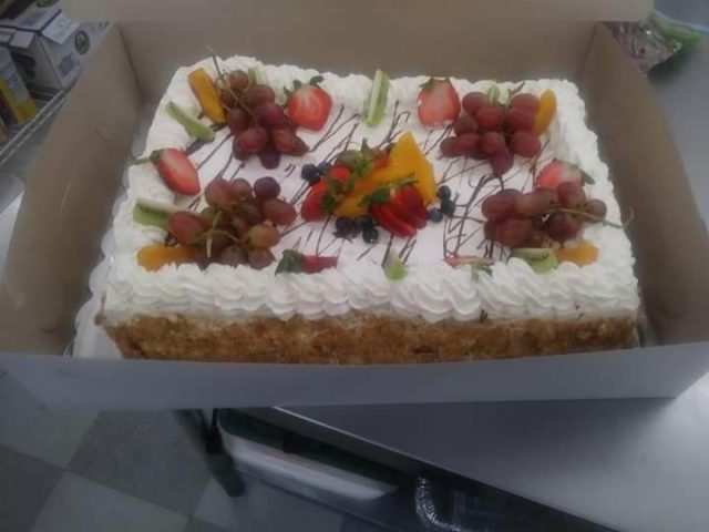 tres leches cake with fruit decorations