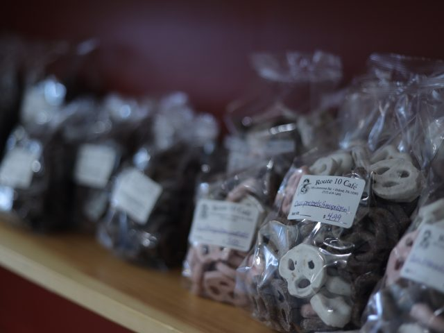 different varieties of bagged chocolate covered pretzels for sale