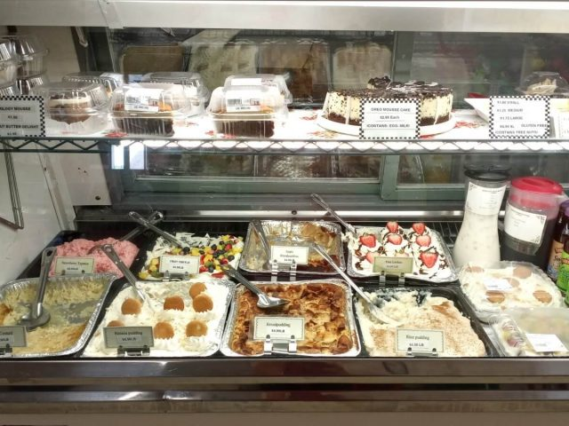spread of homemade desserts and puddings for sale