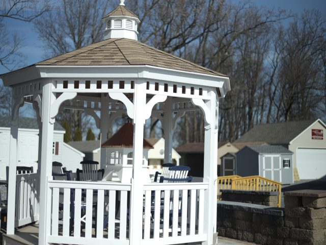 white vinyl gazebo on display at outdoor farmers market in pa